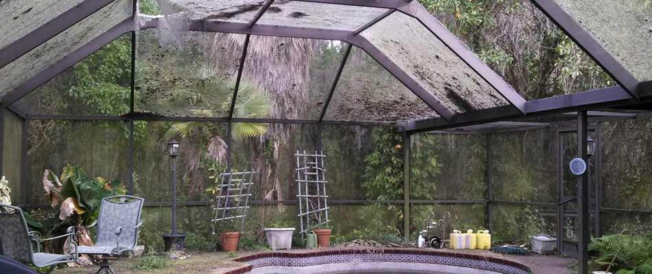 Damaged pool cage needing replacement in Wesley Chapel, FL.