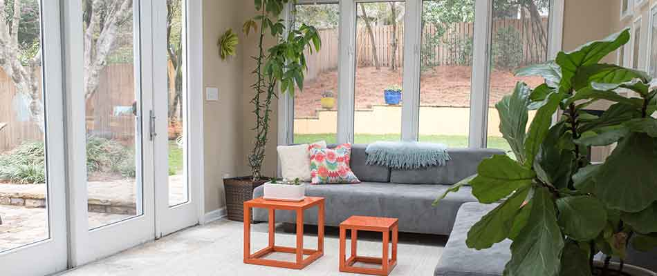 Sunroom with a door leading out to the backyard of a Wesley Chapel home.