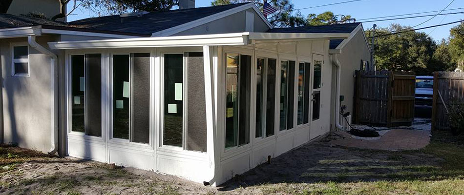 This sunroom in Plant City, FL provides a cool way to enjoy outdoor scenery.