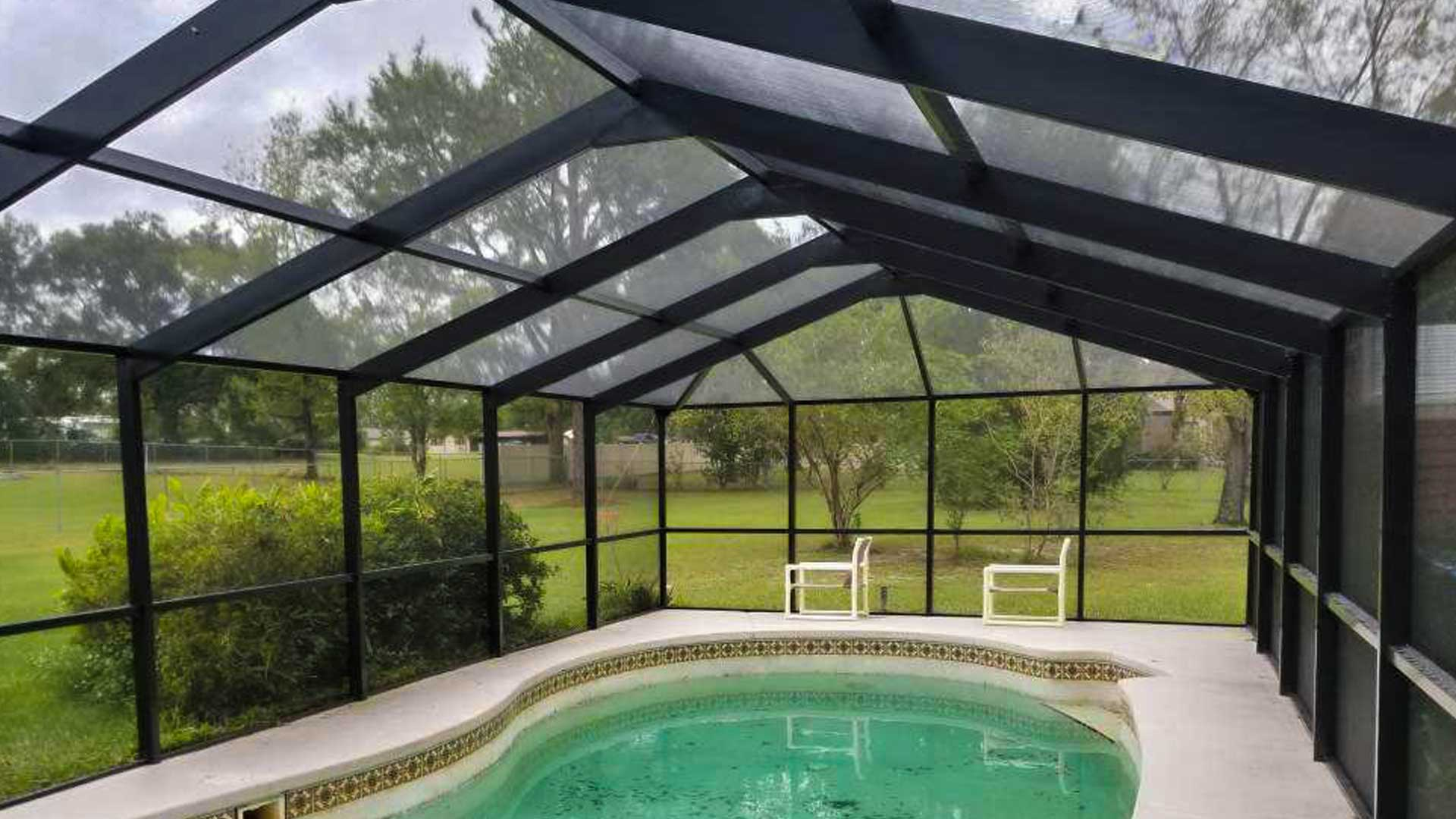After our client's pool cage collapsed, we built a new aluminum pool cage at their home in Lakeland.