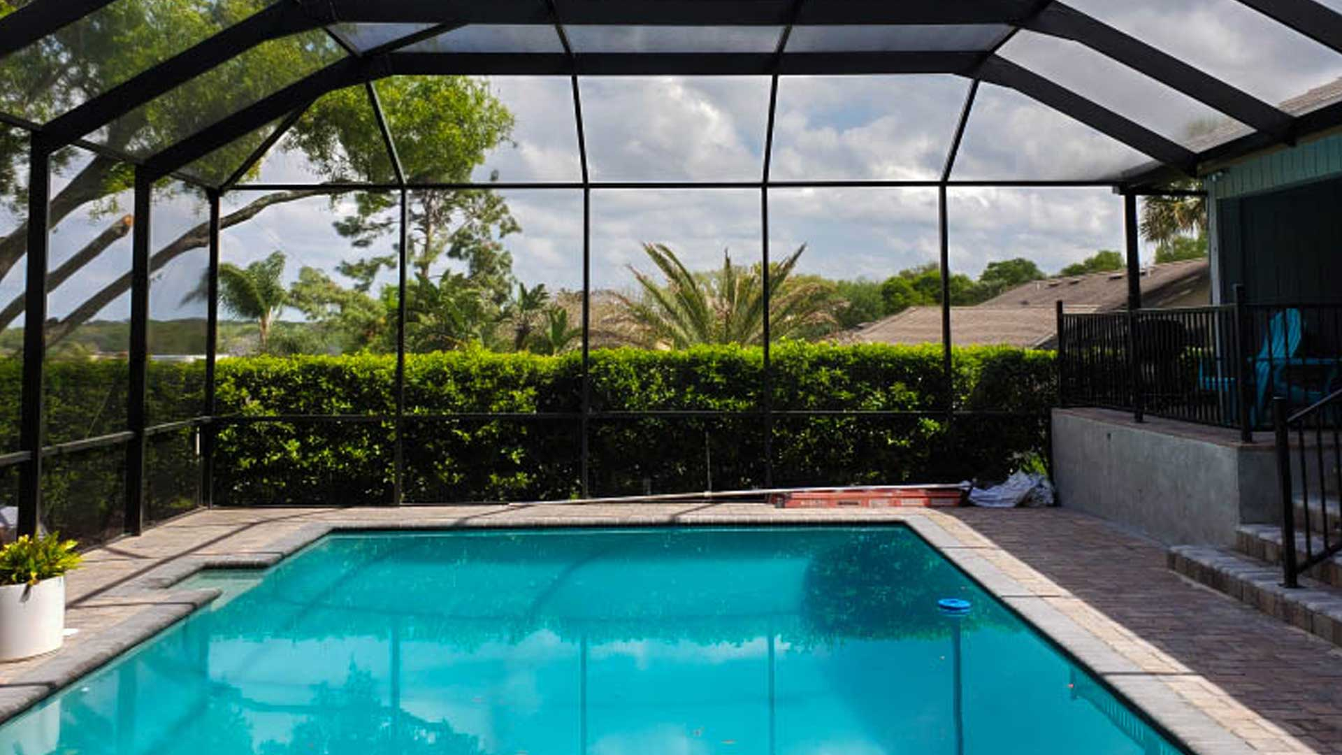 A new aluminum pool cage in the backyard of a property in Plant City, FL.