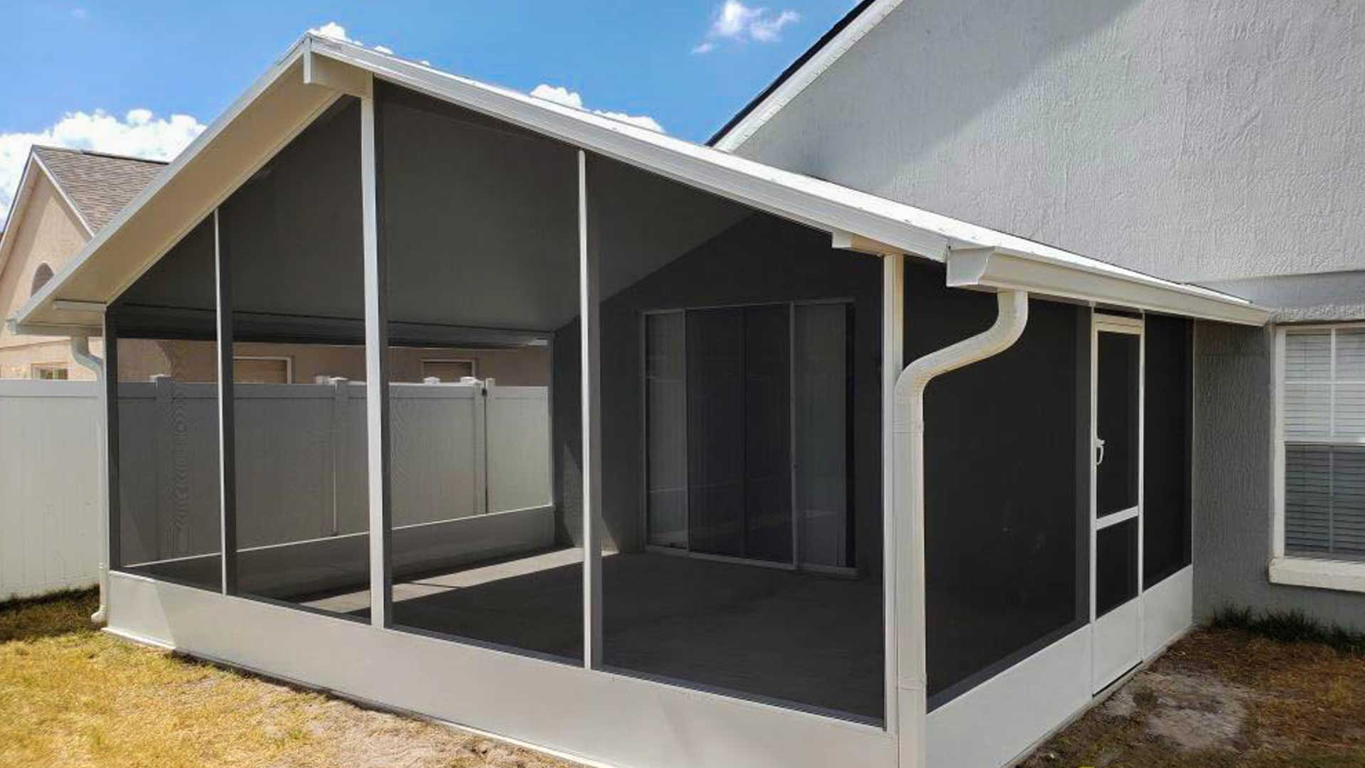A new aluminum screen room constructed in the backyard of a home in Lakeland.